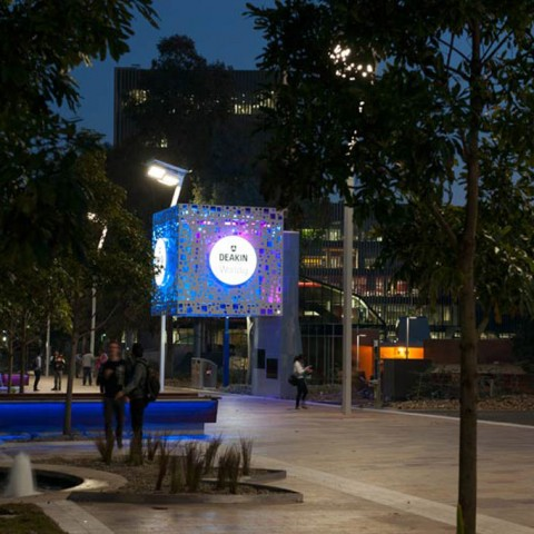 Precast concrete seating lit up at nighttime - Deakin Burwood